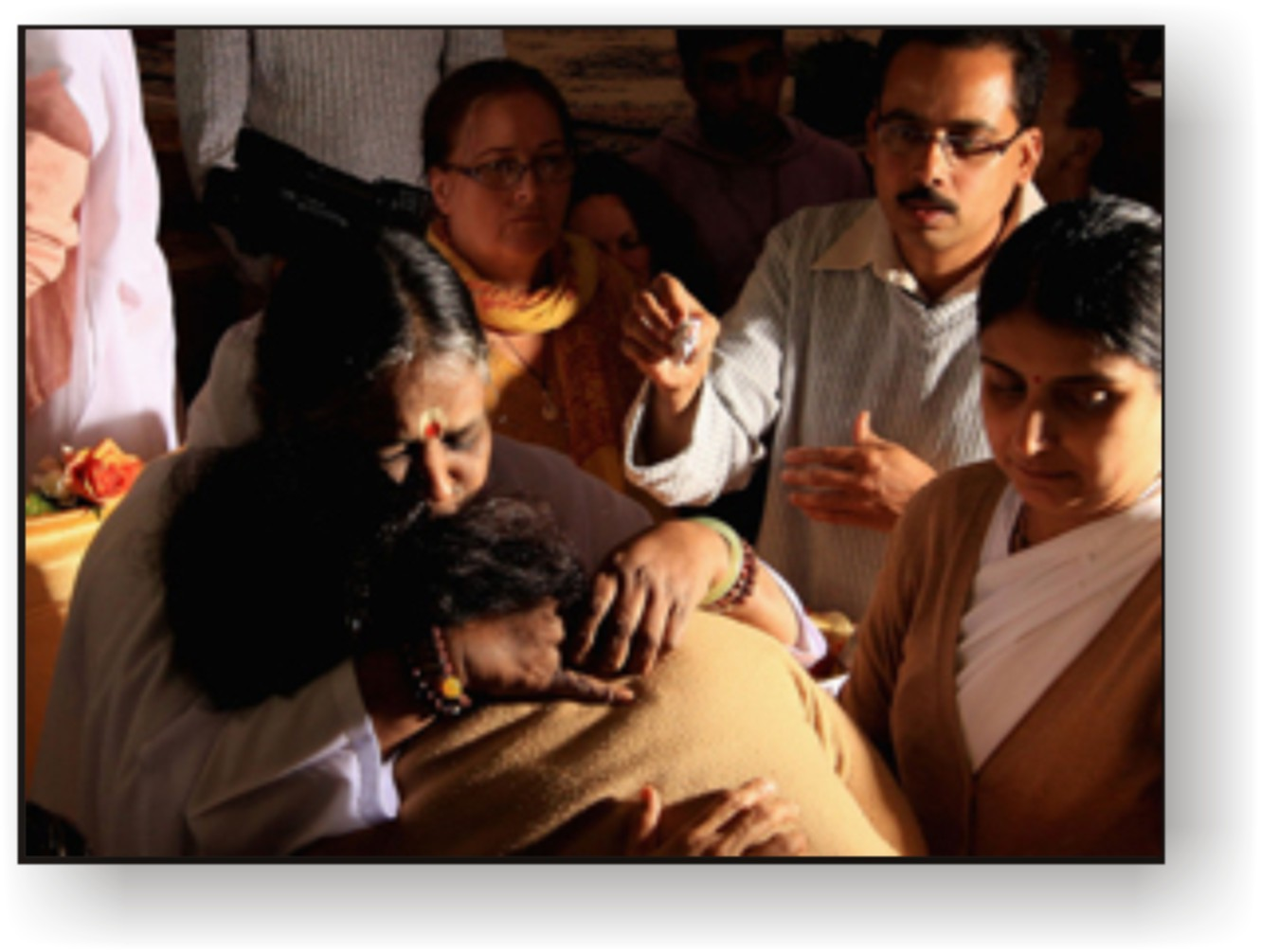 Amma hugging people